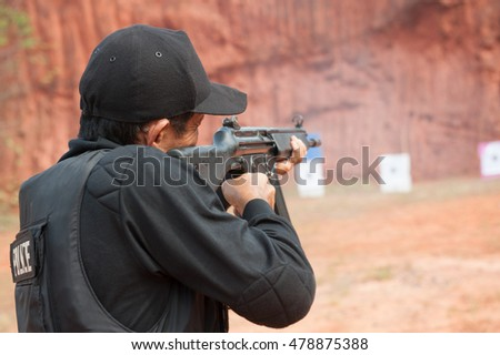 police man and women special operations practicing armed with rifle