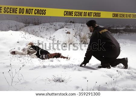 Police man observing place of violent crime - stock photo