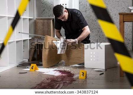 Police officer found documents at the crime scene  - stock photo