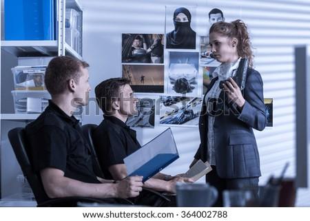 Police officer holding handgun - evidence of crime - stock photo