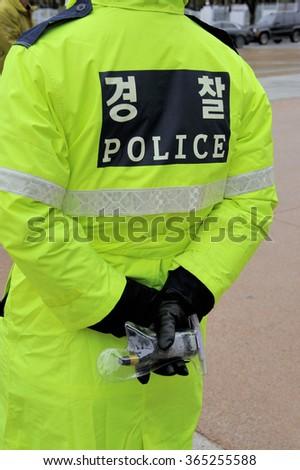 Police officer in Seoul, South Korea - stock photo