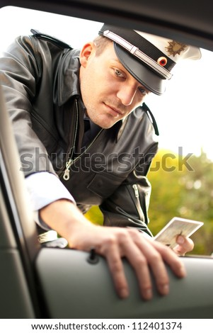 Police officer is doing a traffic check - stock photo