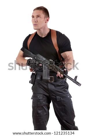 Police officer is holding Kalashnikov. Isolated on white. - stock photo