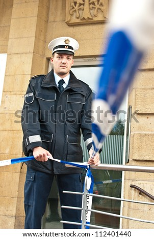Police officer is isolating a crime scene - stock photo