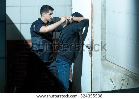 Police officer is very professional and brave in his work  - stock photo