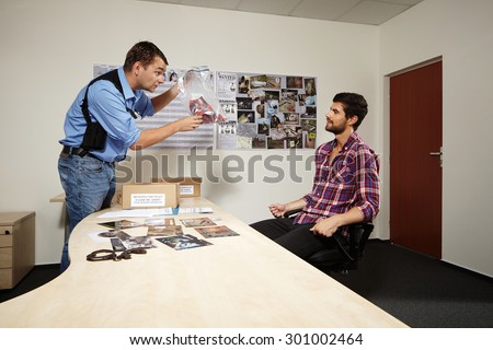 Police officer presenting evidences - stock photo