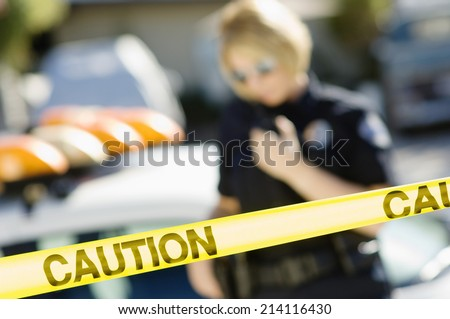 Police Officer Using Two-Way Radio - stock photo