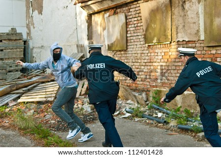 Police officers are chasing a criminal - stock photo