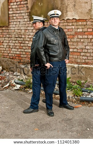 Police officers are poising - stock photo