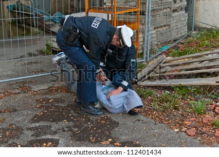 Police officers arresting a criminal