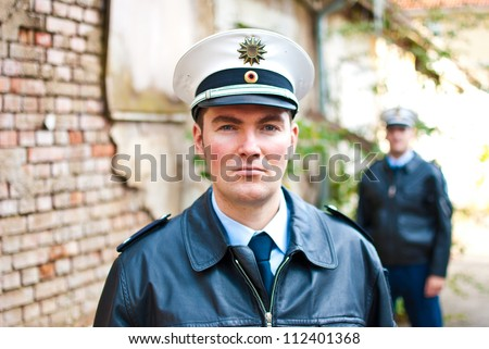 Police officers with a serious face - stock photo