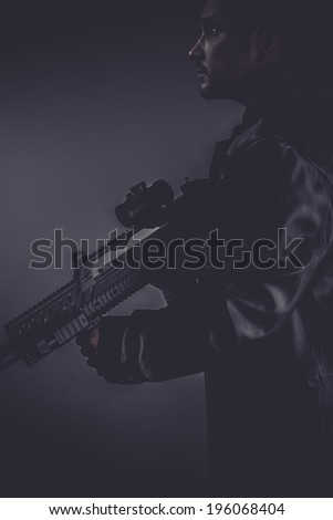 police, portrait of murderer with gun - stock photo