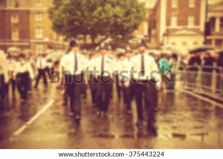police presence blurred - stock photo