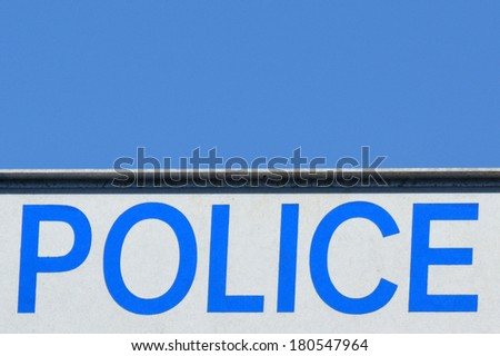 Police road sign with text against blue sky. concept photo of security. - stock photo