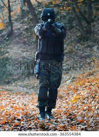 Police special forces,filtered and under exposed photo.National flag on his arms - stock photo