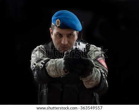Police special forces, under exposed photo.National flag on his arms