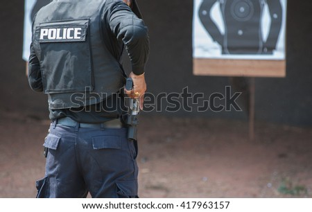 Police special operations practicing in fire pistol shooting.