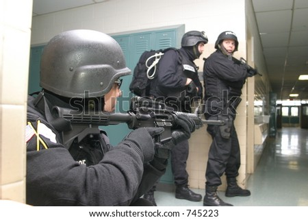 Police special tactics team during an anti-terrorism drill. Editorial use only.
