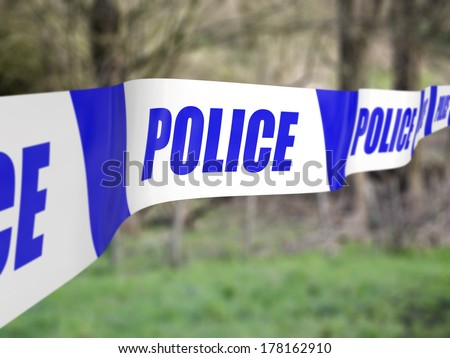 Police tape used to cordon off an incident - stock photo