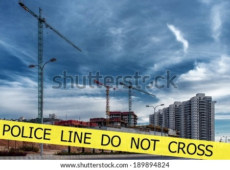 Police tapes POLICE LINE DO NOT CROSS on constraction site background - stock photo