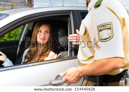 Police - young woman with policeman or cop on the street or traffic - stock photo