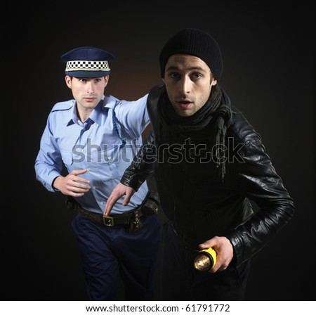 Policeman and thief. Robbery scene. - stock photo