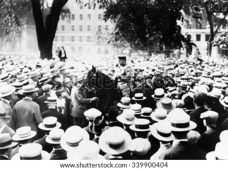 Policeman drives his horse through the crowds on Boston Common during a Sacco-Vanzetti protest. Speakers and Spectators were arrested. 1927. - stock photo
