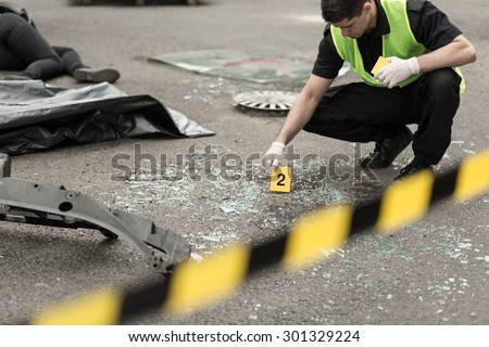 Policeman during investigation at road accident area - stock photo