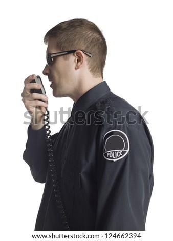 Policeman having radio conversation - stock photo