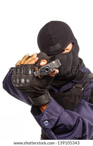 Policeman in black mask targeting with a handgun