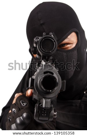 Policeman in black mask targeting with a Rifle - stock photo