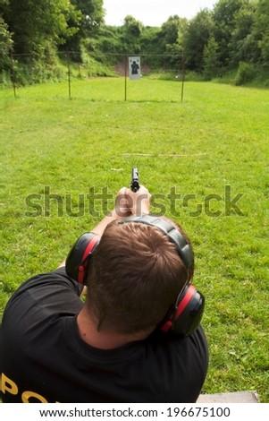 policeman on the range - stock photo