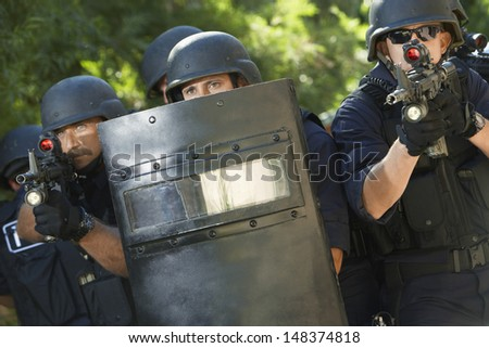 Policemen with guns and shield in training