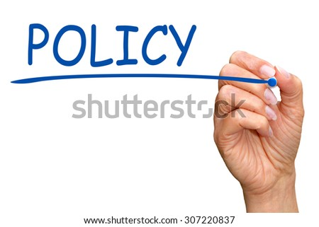 Policy - female hand with pen writing blue text on white background