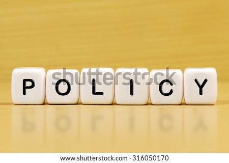 POLICY word on blocks - stock photo