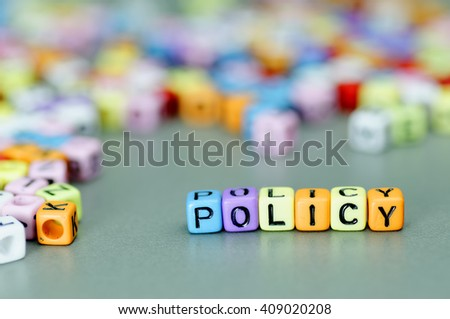 Policy word on colorful dices - stock photo
