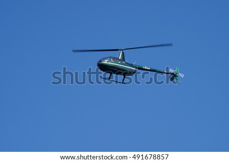Polignano a Mare, southern italy, August 27-2016: Helicopter flying over the sea in a beautiful sunny day