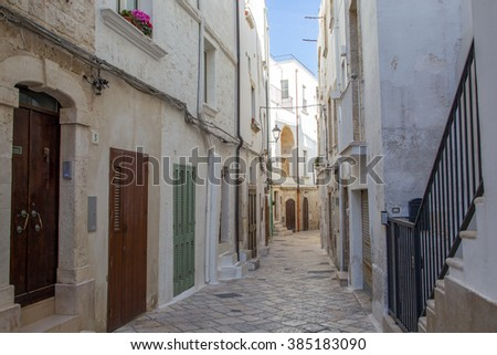 Polignano a Mare, street view in small town built on rocks in Bari, Apulia, Italy