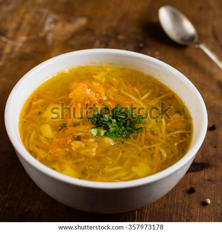 Polish cabbage soup on a brown, vintage table - stock photo
