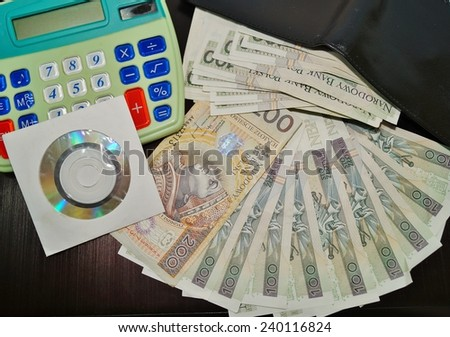 Polish currency - PLN ,Polish zloty - banknotes and calculator - stock photo