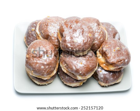 Polish donuts on plate shot on white                                - stock photo