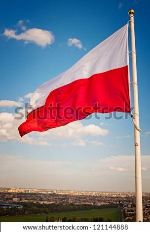 Polish flag against the sky - stock photo