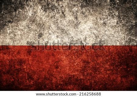 Polish flag on the grunge concrete wall - stock photo