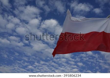 polish flag poland flag poland flag in front of sky  - stock photo