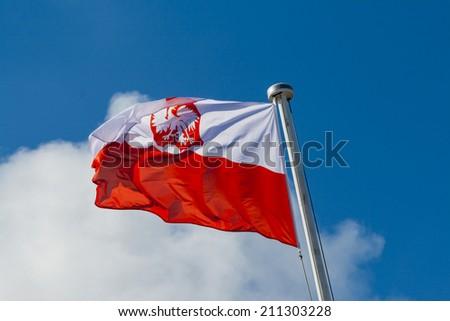 Polish flag waving on mast  - stock photo