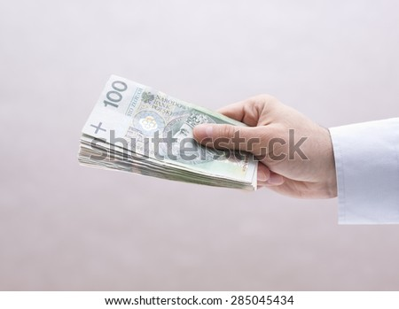 Polish money in hand - stock photo