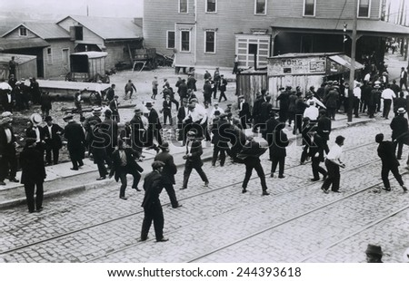 Polish oil refinery workers in Bayonne, New Jersey, confront company guards outside the Standard Oil Works moments before the private police opened fire. Five strikers were killed. July 22, 1915. - stock photo