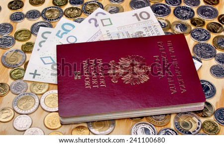 Polish passport and money coins on the table - stock photo