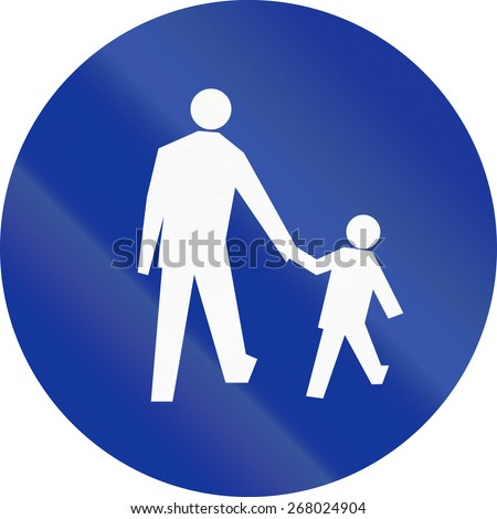 Polish sign at a pedestrian lane depicting father and child.