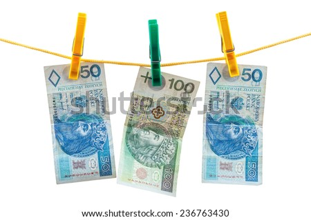 Polish zloty banknotes on clothesline isolated on white background with clipping path - stock photo